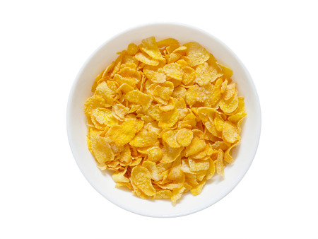 Golden cornflakes breakfast cereal isolated on white background with clipping path. Top view. Healthy breakfast concept.