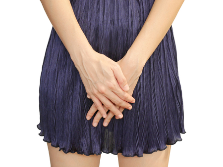 Woman with hands holding her crotch isolated on white background Stock Photo