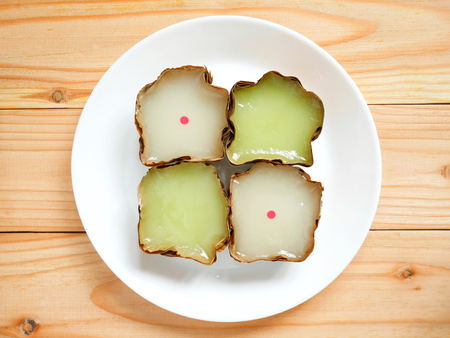Nian gao, nin gou or Chinese New Year's cake (rice cake) made from glutinous rice on white plate Stockfoto