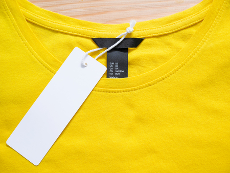 Blank price tag label with yellow t-shirt 版權商用圖片