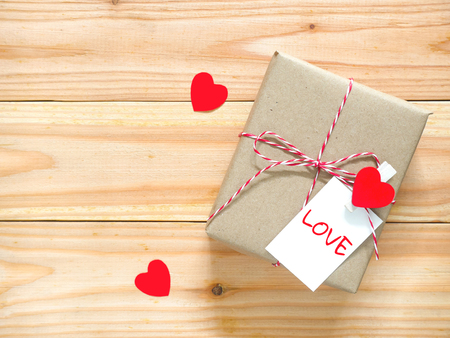 Valentines Day gift box with greeting card on wooden table. Copy space. Top view. Stock Photo