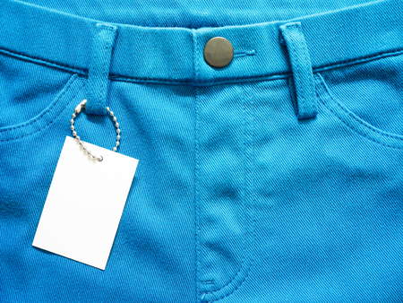 Blank price tag label with blue pants