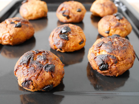 Burned cornflake and raisin cookies on a tray in oven Stok Fotoğraf