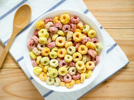 Colorful fruity breakfast cereal in a bowl on wooden Reklamní fotografie