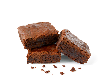 Pile of brownies with crumbs isolated on white Imagens