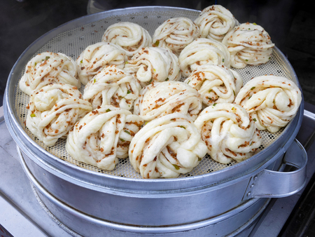 Chinese steamed buns or mantou in steamer pot sold in the market in Dali, China Reklamní fotografie