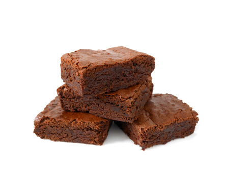 Pile of homemade chocolate brownies isolated on white