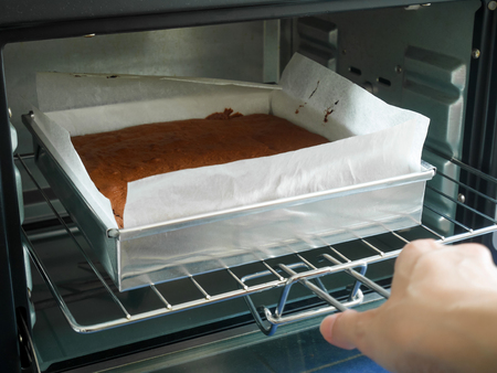 Homemade chocolate brownie baking in the oven