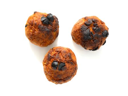 Burned cornflakes and raisin cookies isolated on white Reklamní fotografie
