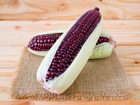 Purple corn or purple maize on wooden Reklamní fotografie