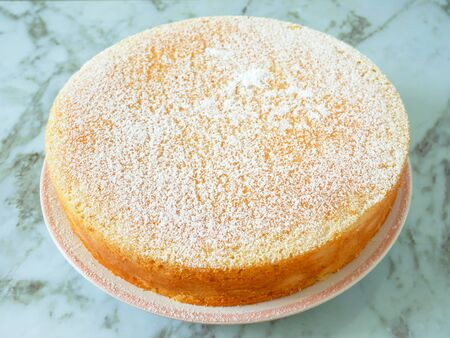 Homemade yogurt cake with icing sugar. Close up.