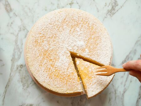 Homemade yogurt cake with icing sugar. Close up. Top view. Reklamní fotografie