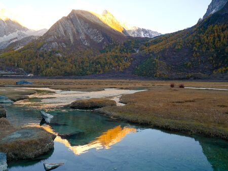 Chonggu meadow with snow-capped mountains in the  in Yading Nature Reserve, Sichuan, China
