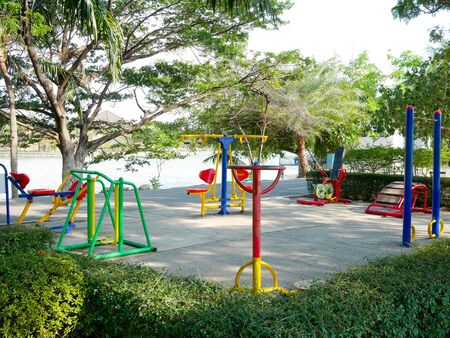 Colorful exercise equipment in the park in evening