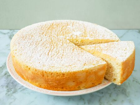 Homemade yogurt cake with icing sugar. Close up.
