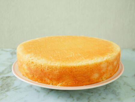 Homemade yogurt cake on a white plate