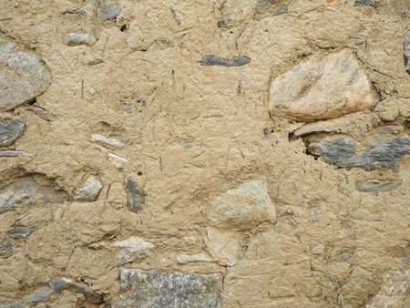 Beige stone wall texture background
