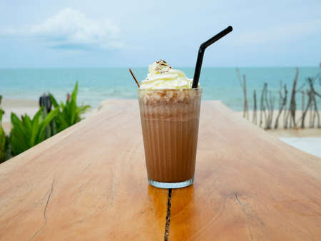 Chocolate frappe or chocolate ice blended with whipped cream on wooden table Banco de Imagens