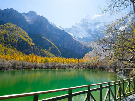 Pearl Lake or Zhuoma La Lake and snow mountain in autumn in Yading Nature reserve, Sichuan, China. Beautiful nature landscape.