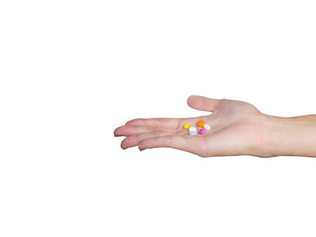 Hand holding colorful medicines and pills isolated on white background with clipping path