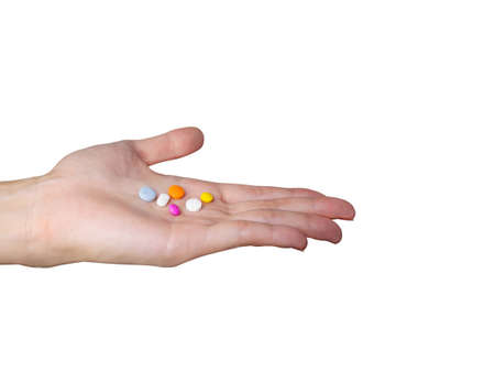 Hand holding colorful medicines and pills isolated on white background Stock fotó