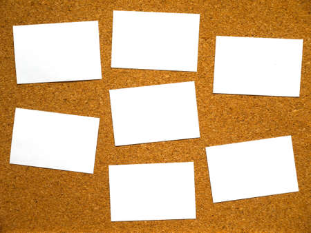 Blank papers on cork board for writing