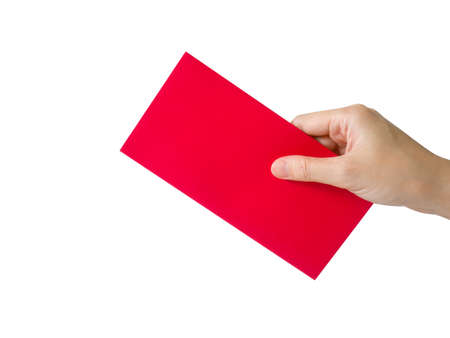 Hand holding red packet or red envelope isolated on white background. Chinese New Year or Lunar New Year concept.