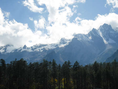 Snow covered mountain peaks at Jade Dragon Snow Mountain. Snow mountain landscape. Stock fotó