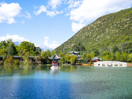 Scenery of Black Dragon Pool in Jade Spring Park (Yu Quan Gong Yuan) with Jade Dragon Snow Mountain in the background.
