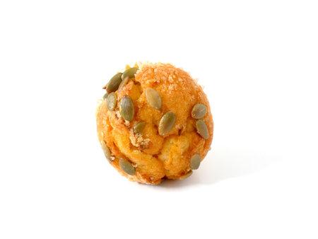 Pumpkin muffin topped with pumpkin seeds
