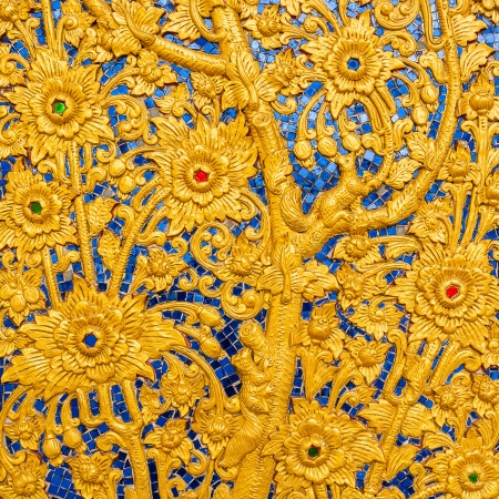 Wooden doors carved into flowers decorated with stained glass, Thai Art. Stock Photo - 19614945