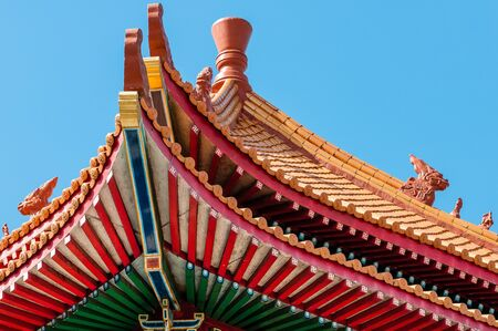 elaborate: Elaborate design On The Eave Of A Chinese Temple in Thailand
