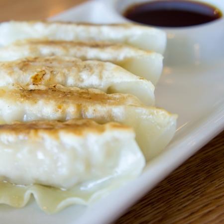 Dim-sum call Gyoza Japanese  food on white plate photo