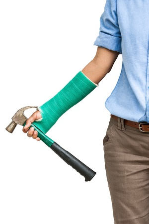 chippy: woman with arm and hand in cast  with an iron hammer in a hand  isolated in white