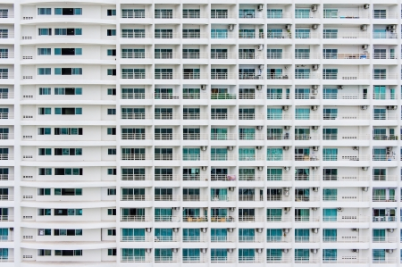 Pattern of hotel room balconies in modern building photo