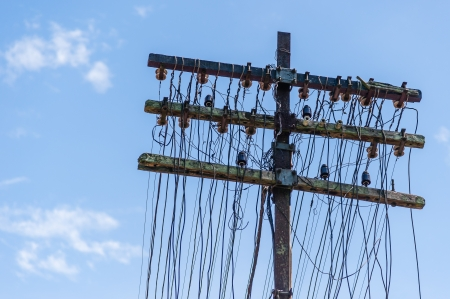 Antique telephone pole with glass insulators
