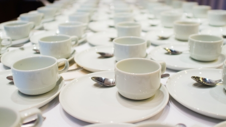 Lines of coffee cups in front of conference room