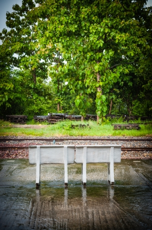 chairs at station platform in the north of thailand on a rainy day Stock Photo - 20984360