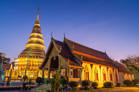 Wat phra that hariphunchai was a measure of the Lamphun,Thailand at Twilight Time  photo