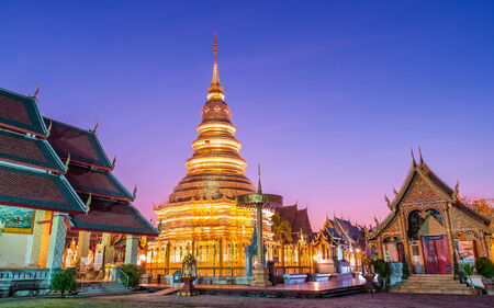 hariphunchai: Wat phra that hariphunchai was a measure of the Lamphun,Thailand at Twilight Time  Stock Photo