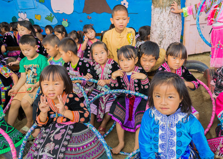 MON CHAM, CHIANGMAITHAILAND - November 15: Unidentified traditionally dressed Hmong hill tribe children in Hmong new year festival on November 15, 2013.CHIANGMAI THAILAND