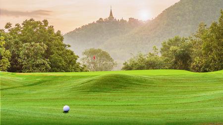 golf green: golf ball on green. Stock Photo