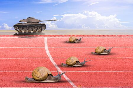 Snail effort running on red rubber track photo