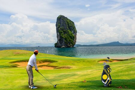 golf equipment on green and hole as background. photo
