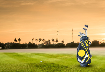 pitching: golf equipment and golf ball on green .