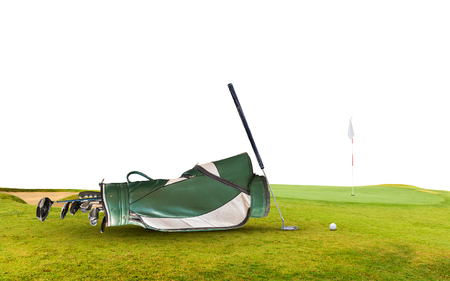 pitching: golf equipment and golf bag on green and hole as background Stock Photo