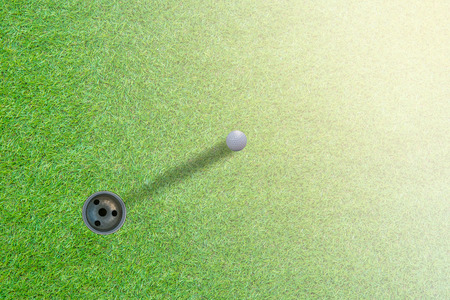 golf ball on green top view.with space for text.