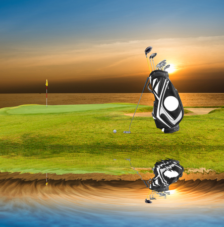Golf equipment , golf bag ,putter ,ball on green with beautiful light reflect on the water.
