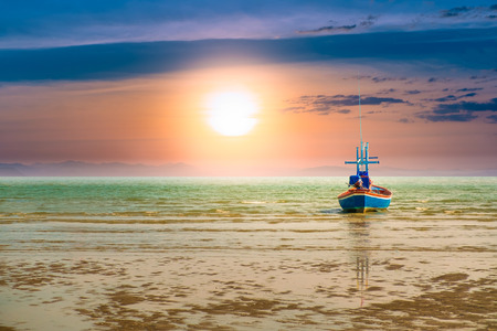 Fishing boat in the sea to catch fish out the morning sunset on a beautiful day. Pictures of imagination.hope and success concept.