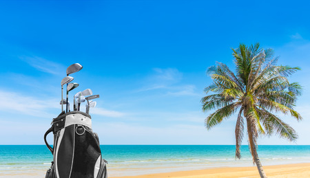 Golf bag and Golf club sea and blue sky as background . Business, Health with relaxation concepts.
